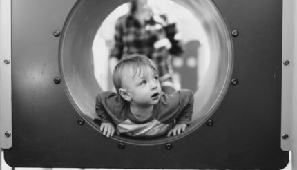 child looking out of tunnel